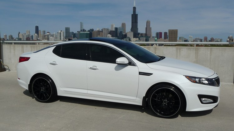 white rims white rims  kia optima