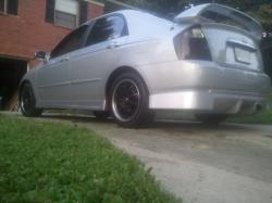 Fooly Cooley 2006 Kia Spectra