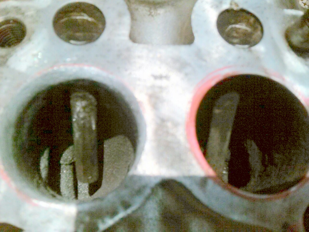 Opening up exhaust ports, removing aluminum pipes for better flow. - 19047441