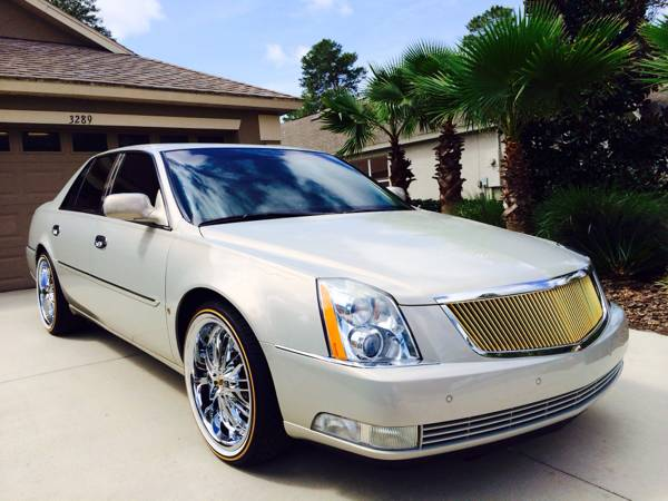 Cadillac dts with vogues tires rims
