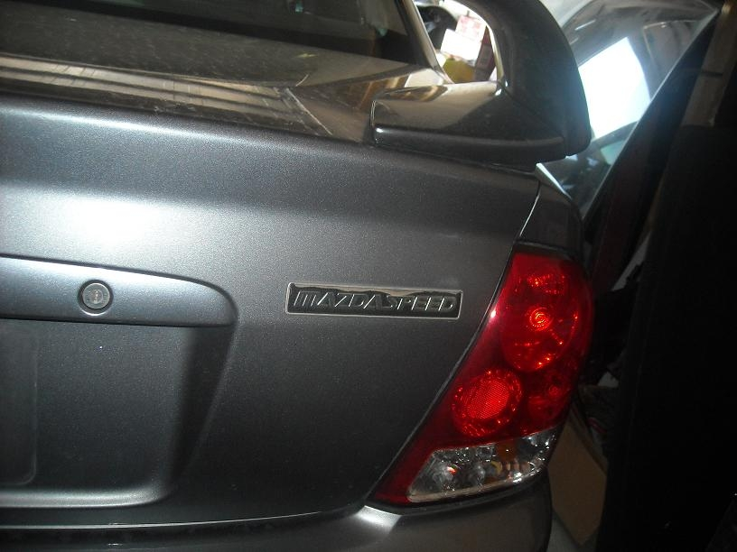 Another 20EVOLUTION01 2003 Mazda Protege post... - 5233207
