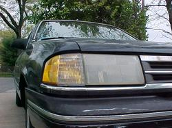 stained 1990 Ford Tempo