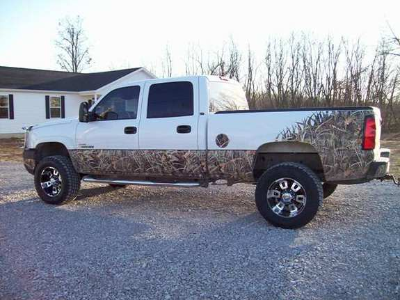 White Chevy Truck with Camo