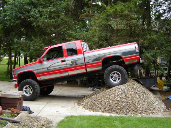 1995 GMC sierra with a 6in suspenson lift and a 2in body lift siting
