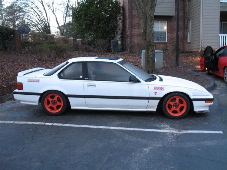 black car orange rims