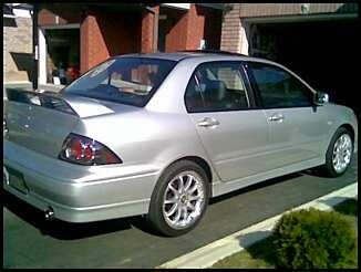 Another lancer_ozralley 2003 Mitsubishi Lancer post... - 8760412
