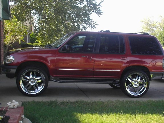 1998 metallic red ford explorer on 23s24s and now 26s wit the - Red Ford Explorer Black Rims
