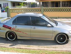 TRINISYRIANs 2002 Mitsubishi Lancer