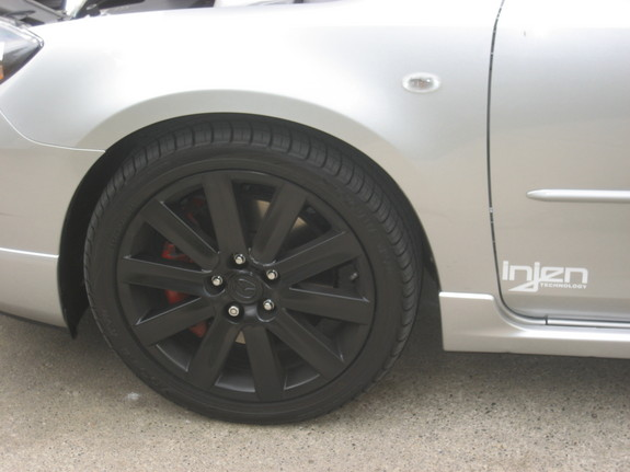 2008 MS3; Blacked out stock rims-full tint/20%-5%-blacked out badgesBlacked out Stocks w/red calipers and Injen graphixBlacked out Badges
