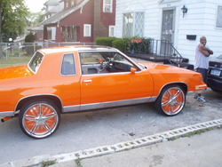 ORANGE_CREAM 1984 Oldsmobile Cutlass Calais