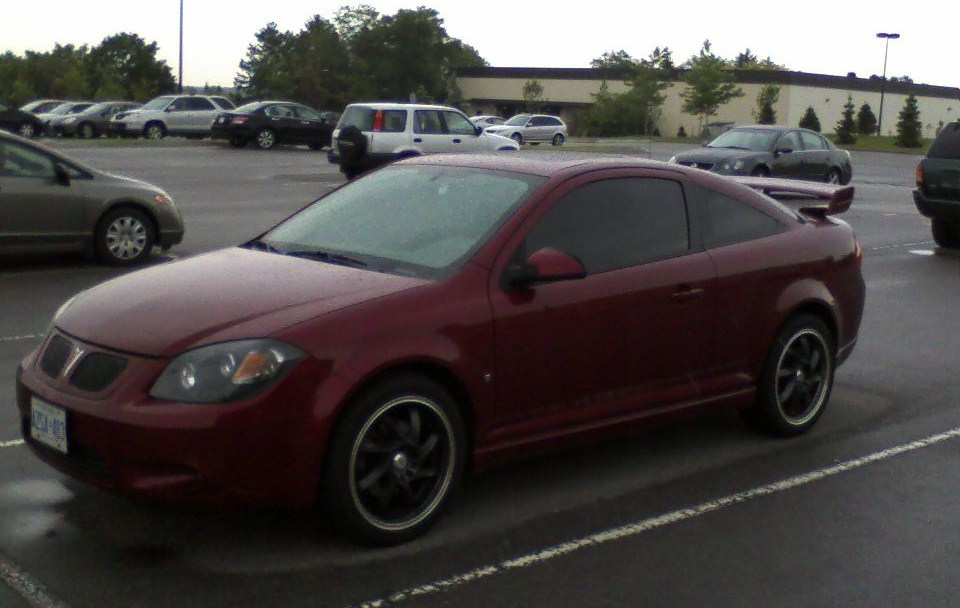 anyone running black 17 rims on a prt g5 2009 Pontiac G5 here s one with the lights kinda bad quality