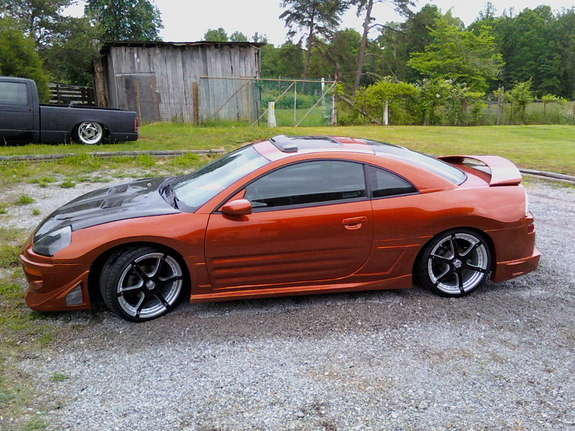 this is my 2000 mitsubishi eclipse with a custom pearl oraange paint job it has