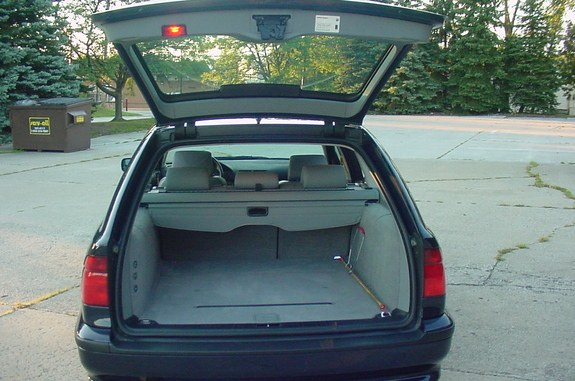 need help location of the fuse boxs and overview of fuse the 2 pre wired buttons are located on the left side of the trunk near the audio component fold down door in this image of an e39 sedan below