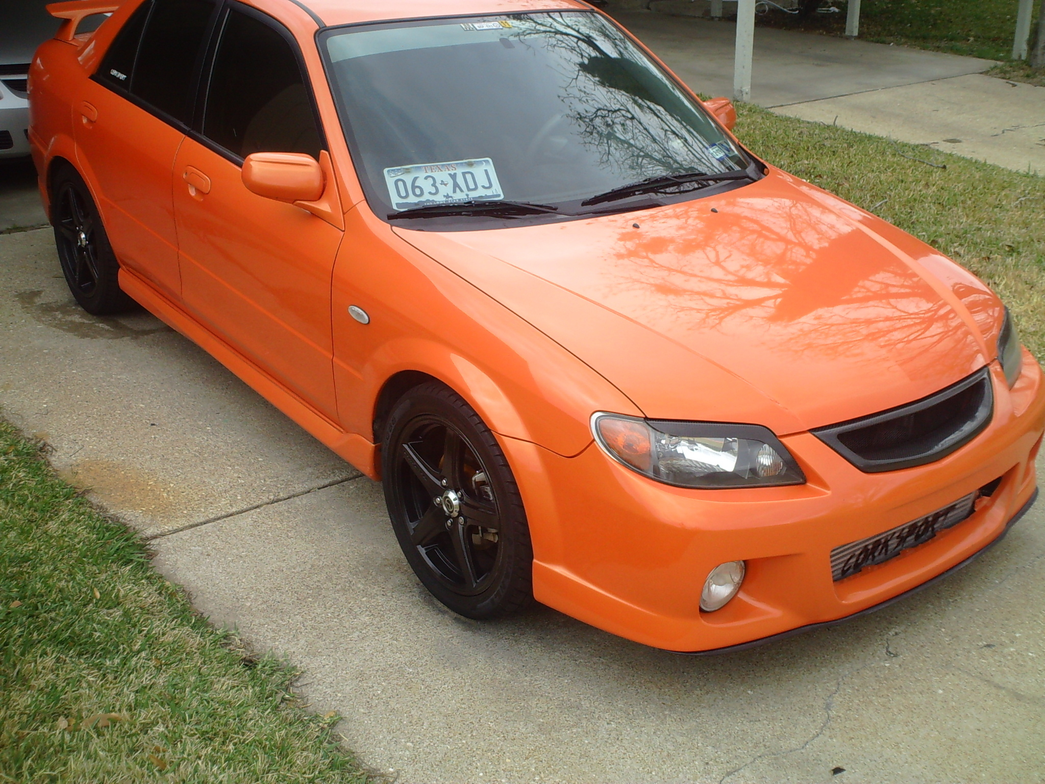 Another Marios-03_MSP 2003 Mazda Protege post... - 12572554