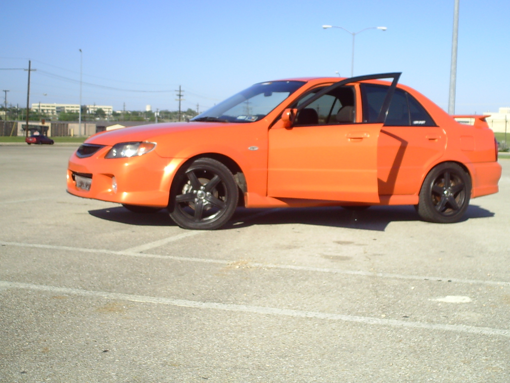 Another Marios-03_MSP 2003 Mazda Protege post... - 12572584