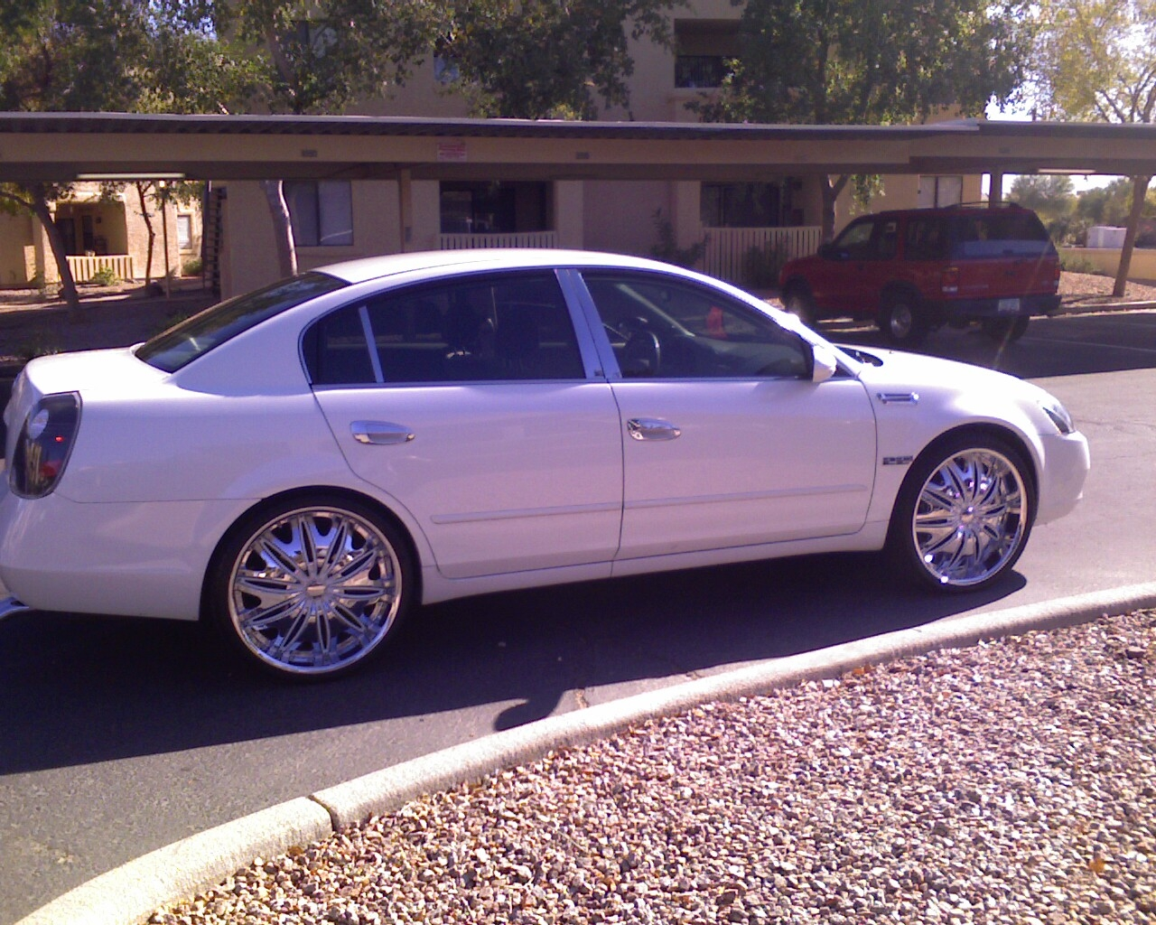 Another azsickest 2004 nissan altima post photo 12463575 white and crome 22 inch velocity wheels im back in the game vanachro Gallery