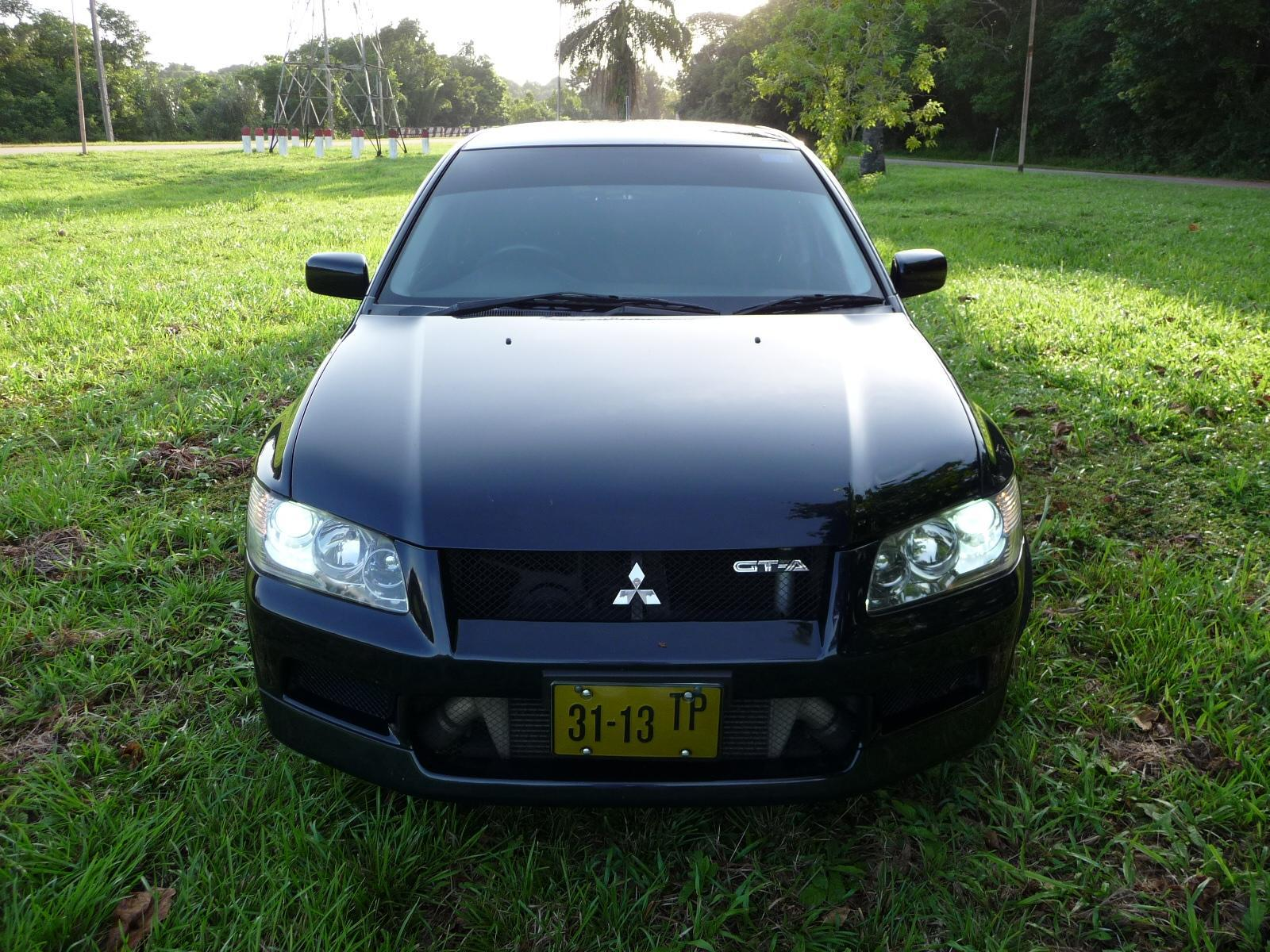 Another djoembie 2002 Mitsubishi Lancer post... - 12976468