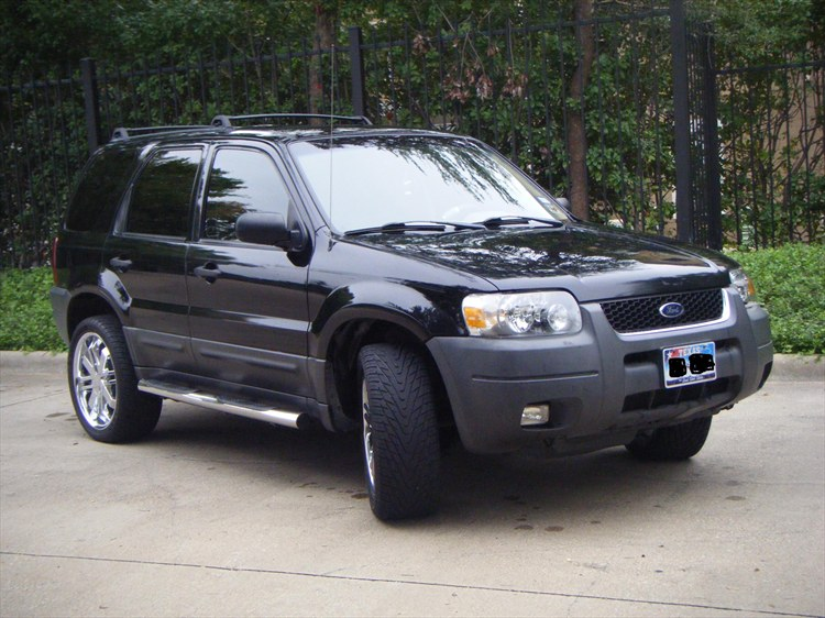 Ford Escape Black Rims http://www.cardomain.com/ride/3804327/2004-ford-escape/