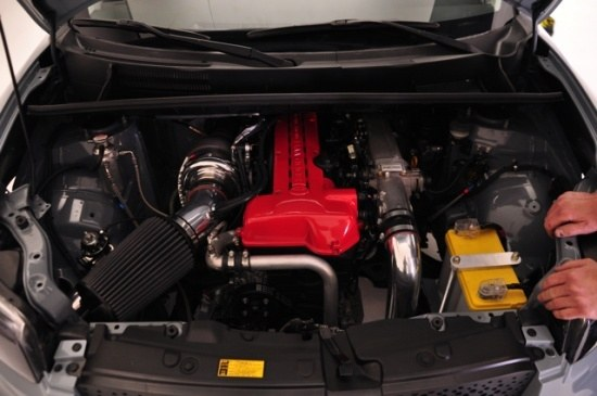 single turbo 2JZ in engine bay of Scion xB