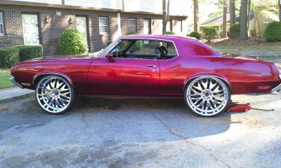 72 Cutlass on 26s http://www.cardomain.com/ride/3854672/1971-oldsmobile-cutlass-supreme/