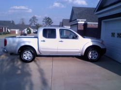 trigged 2011 Nissan Frontier Crew Cab