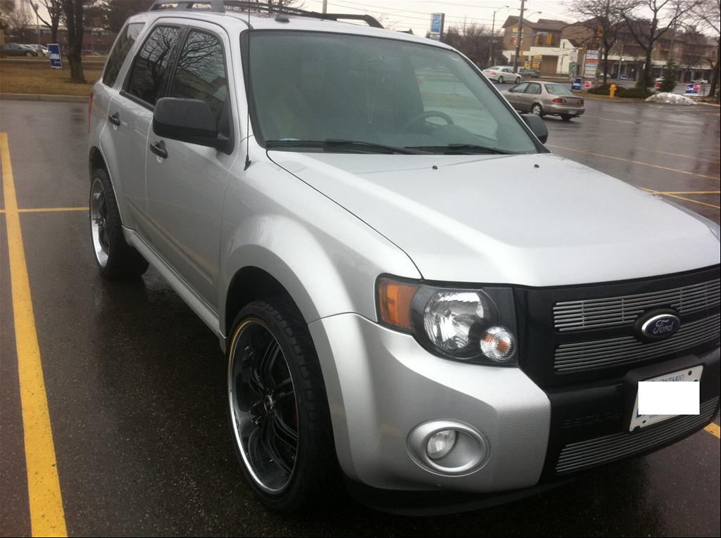 Ford Escape Black Rims http://www.cardomain.com/ride/3915151/2010-ford-escape-xlt/