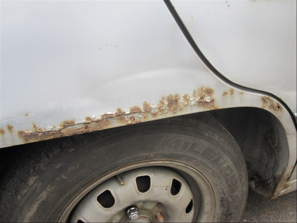 heavily rusted rocker panel..