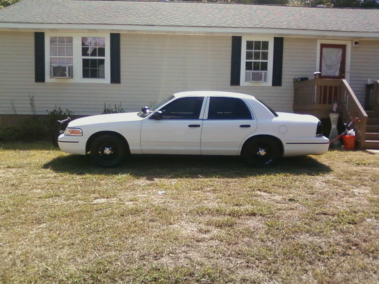 99whitep71 1999 Ford Crown Victoria
